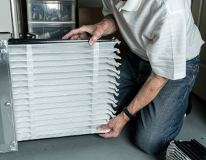 Changing the furnace filter in a house in Glen Ellyn, Illinois